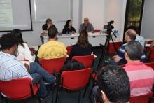 Formando a Mesa, o Prof. Ricardo Ismael (CIS), Rosa Freire d'Aguiar Furtado e o Prof. Eduardo Raposo (CIS), no auditório do IAG.