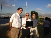 O Secretário Estadual de C&T, Alexandre Cardoso, e os coordenadores do projeto professores Flávio Hasselmann (Cetuc/PUC-Rio) e Pedro Coelho (UERJ). Fonte: divulgação.